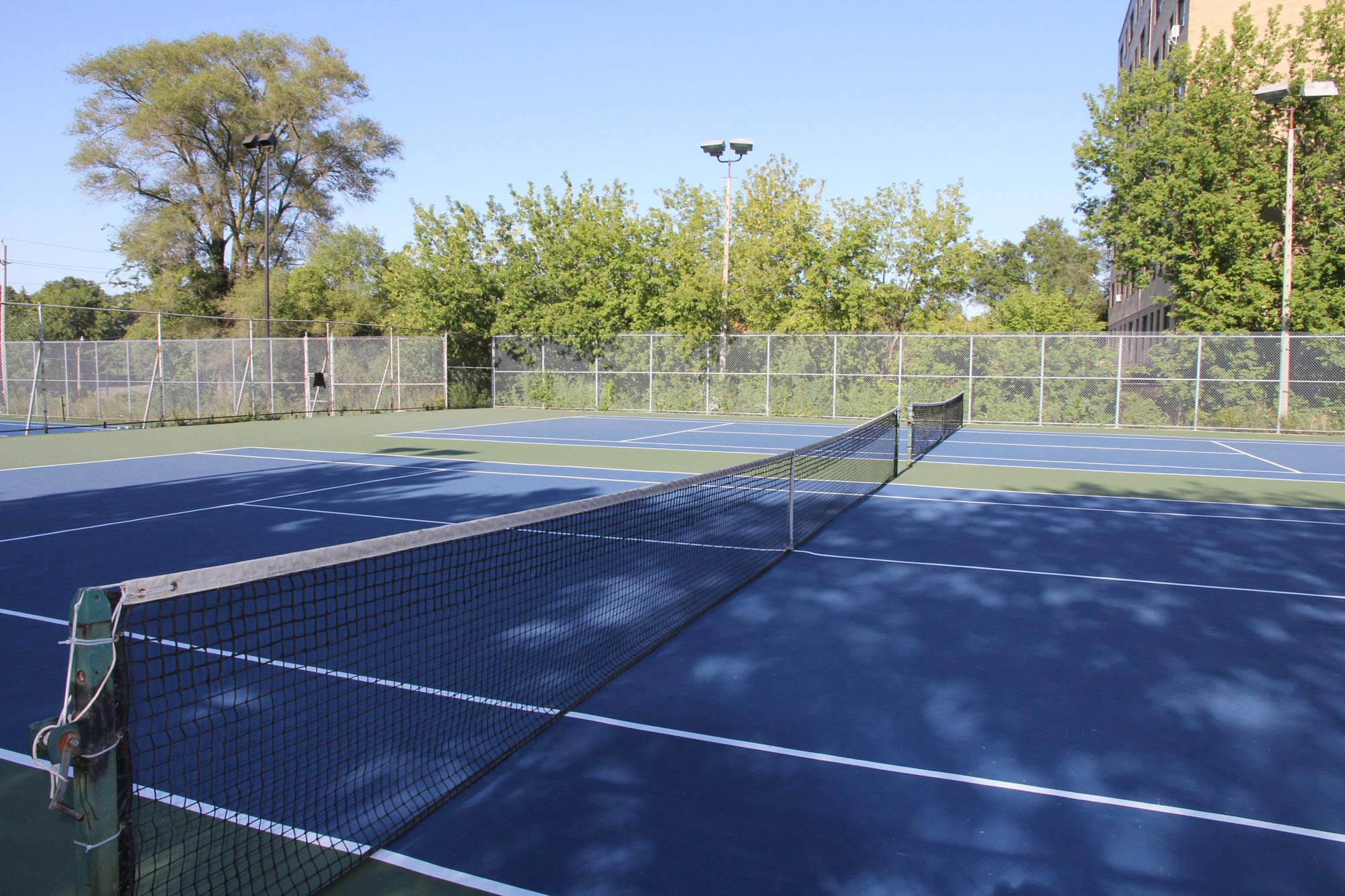 Newly resurfaced blue and green tennis courts in Toronto